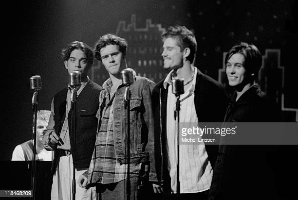 English boy band Take That perform live on stage in the Netherlands in 1993 Left to Right Gary Barlow Robbie Williams Howard Donald Jason Orange and...
