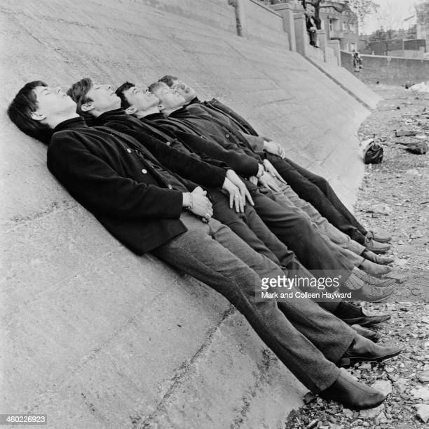 English rock and roll group The Rolling Stones posed on Chelsea Embankment by the river Thames in London in 1963 Left to right Keith Richards Charlie...