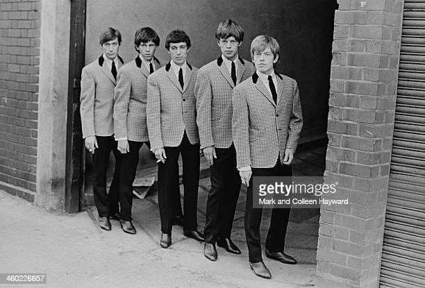 English rock and roll group The Rolling Stones posed wearing matching check jackets in London in 1963 Left to right Charlie Watts Keith Richards Bill...