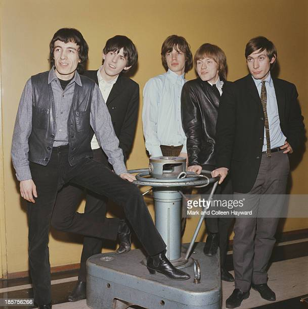 English rock group Rolling Stones posed at the Decca records pressing plant in 1964 Left to right Bill Wyman Keith Richards Mick Jagger Brian Jones...