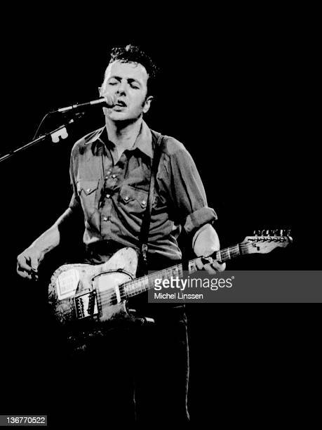 English singer and guitarist and ex member of The Clash Joe Strummer performs live on stage in the Netherlands in 1990