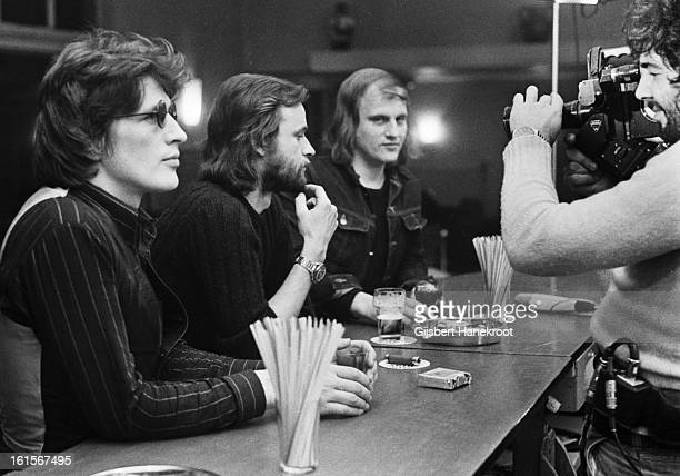 From left to right Dutch singer Herman Brood posed at a bar with guitarist Eelco Gelling and singer Harry Muskee from Cuby Blizzards in the...