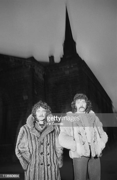 Geezer Butler and Tony Iommi from Black Sabbath pose together in front of a church in Birmingham England in January 1983