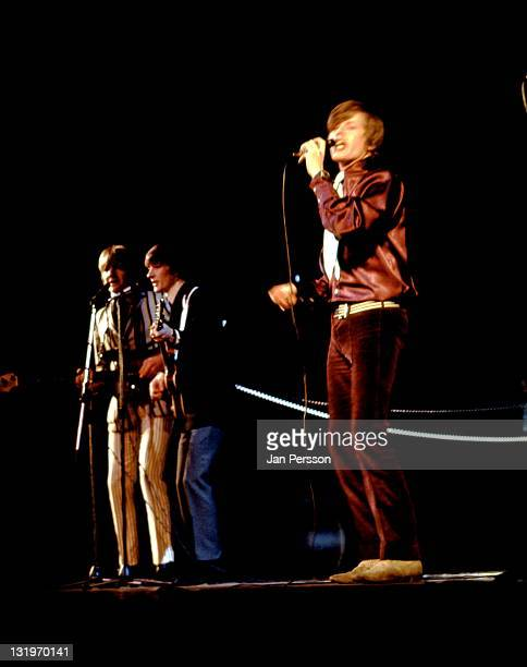 Herman's Hermits perform live on stage in Copenhagen Denmark in January 1967 Left to right bassist Karl Green guitarist Keith Hopwood and singer...