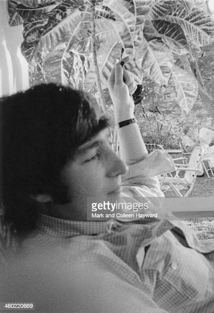 John Lennon from The Beatles relaxes in the shade on holiday in Port Of Spain Trinidad in January 1966