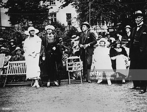 At a tennis party at Lady Wanetree's are Princess Andrew of Greece , the daughter of the British naval commander Prince Louis of Battenberg, , 1st...