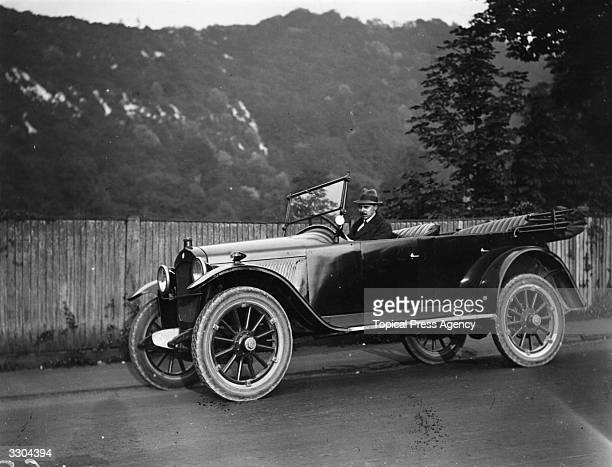 Whilst Yale and Harvard Athletic teams practise at Cambridge Massachusetts Mr Oscar Seyd secretary of the ACU is at the wheel of a convertible Model...