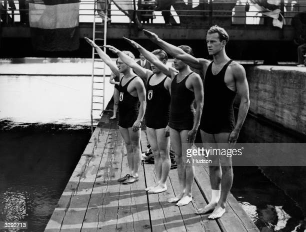 Members of the German swimming team give the Nazi salute during the playing of the German National Anthem at the PLA Swimming Club's Annual Open-Air...