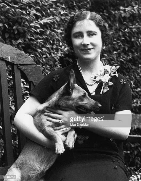 The Duchess of York with one of the Royal Corgis in the grounds of 145 Piccadilly London the Yorks' home before the Duke's accession to the throne