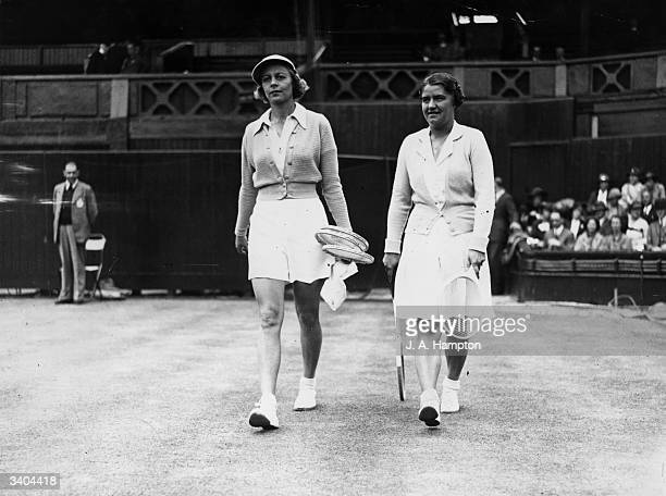 American tennis player Alice Marble and her Polish opponent Jed Jedzrejowska arrive on court for their Women's SemiFinal match in the All England...