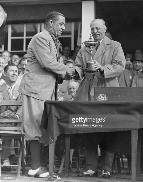 Lord Wardington presenting the Ryder Cup to Walter Hagen at the Ainsdale and Southport Golf Course, Lancashire. Walter Hagen winner of the USPGA and...