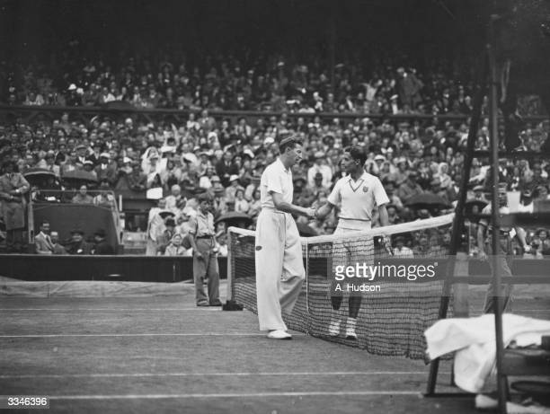 American tennis player Donald Budge shakes hands with British player Bunny Austin after their match in the Men's Singles Final at the Wimbledon...