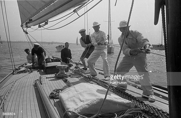 The crew of yacht Evaine hoisting her mainsail to compete in the Royal Harwich Yachting Club's regatta Original Publication Picture Post 163 Yacht...
