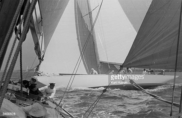 The crew of yacht Evaine sailing on starboard tack ahead of rival yacht Tomahawk in the Royal Harwich Yachting Club's regatta Original Publication...