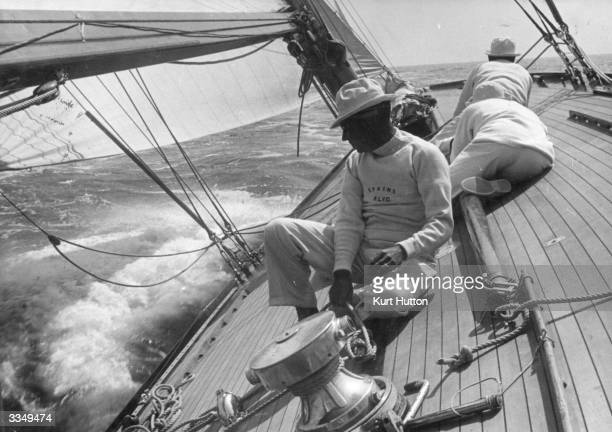 The crew on board 'Evaine' bringing the yacht around on a starboard tack during the Royal Harwich Regatta Original Publication Picture Post 163 Yacht...