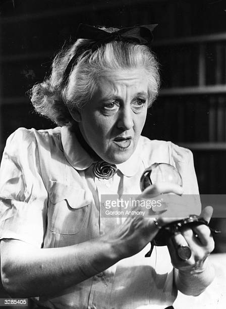 British comic actress Margaret Rutherford plays medium Madame Arcati in a scene from the Noel Coward play 'Blithe Spirit' at the Piccadilly Theatre...