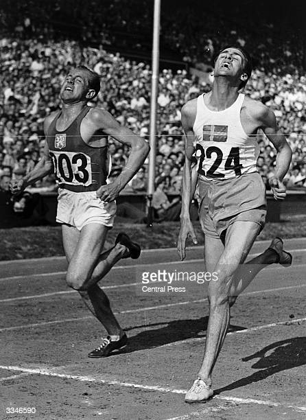 Erik Ahlden of Sweden beats Emil Zatopek of Czechoslovakia to the tape in the second heat of the Olympic 5000 metres at the 1948 London Olympics at...