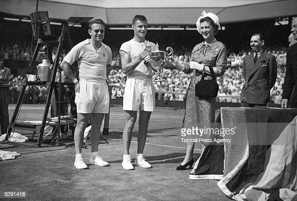The Duchess Marina of Kent presenting the men's singles trophy to Ted Schroeder of the USA watched by Czechborn Egyptian Jaroslav Drobny whom he...