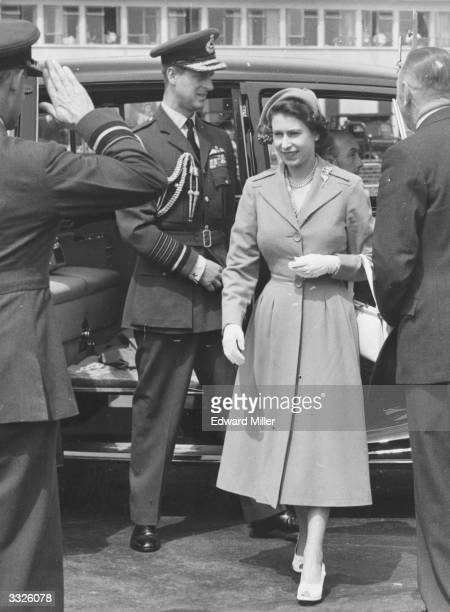 Queen Elizabeth II and the Duke of Edinburgh leaving their car at London Airport before flying to Northern Ireland for a three day tour
