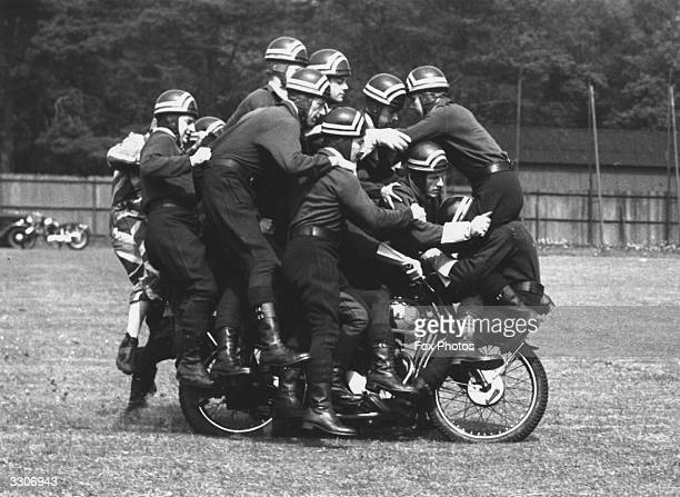 Sixteen members of the motorcycle display team of the Army Mehanical Transport School, Borden, balancing on one motorcycle, during rehearsals for the...