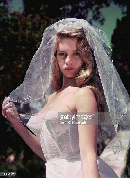 French actress Brigitte Bardot, nicknamed the Sex Kitten, wearing a wedding veil. Original Publication: Picture Post - 8546 - Brigitte Bardot - unpub.