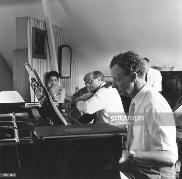 British composer Benjamin Britten at the piano with Russian cellist Mstislav Rostropovich playing Britten's 'Cello Sonata' Russian soprano Galina...