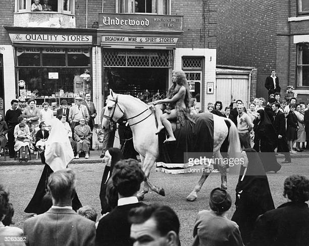 Joyce Parker as Lady Godiva rides through the streets of Coventry during the carnival