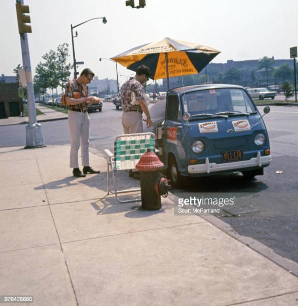 New York City Customers purchase hot dogs from a street vendor in Queens New York