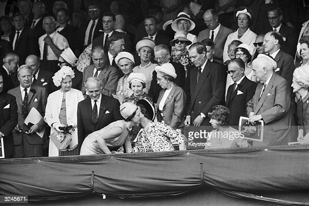 Princess Margaret greets Princess Marina of Kent with a kiss during the final of the Men's Singles at Wimbledon in which Spain's Manuel Santana...
