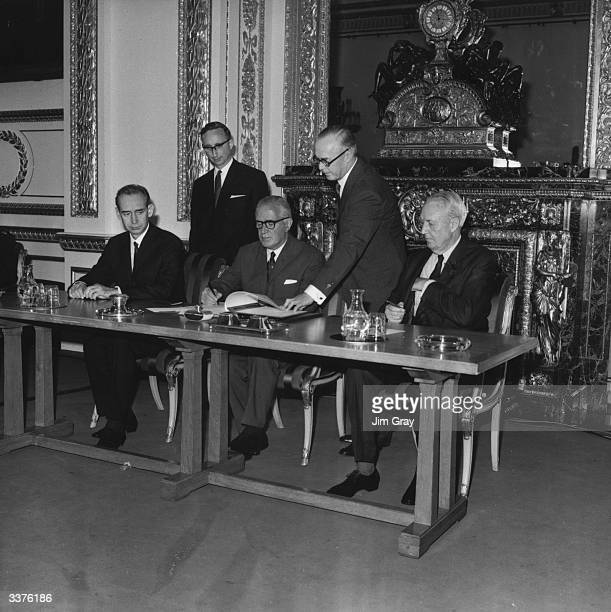 Britain's Foreign Secretary Michael Stewart signs the treaty on the NonProliferation of Nuclear Weapons at Lancaster House London watched by the...