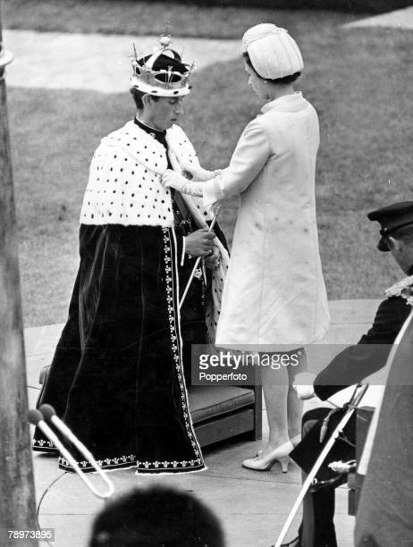1st July 1969 A scene showing the moment when Queen Elizabeth II fastened the ermine mantle around the shoulders of Prince Charles at Caerarvon...