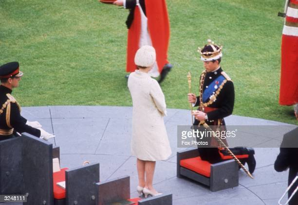 Queen Elizabeth II crowns her son Charles Prince of Wales during his investiture ceremony at Caernarvon Castle