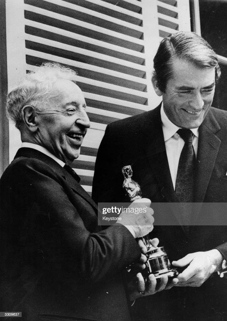 Celebrated pianist, Arthur Rubinstein, receiving the