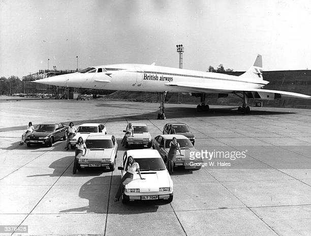 Avis rent a car show their new Rover cars in front of a British airways Concorde at Heathrow airport London