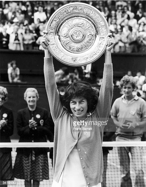 British tennis player Virginia Wade holding up the Women's Singles trophy after beating Holland's Betty Stove in three sets at Wimbledon