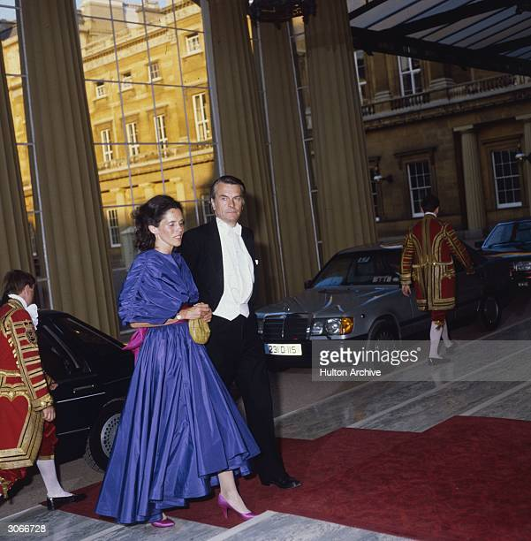 British politician Dr David Owen leader of the SDP arrives at Buckingham Palace London with his wife to attend a dinner in honour of the visiting...