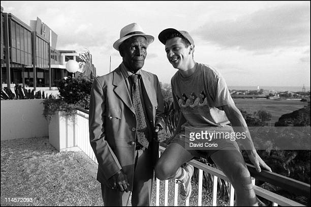 Calypso singer Roaring Lion posed with radio presenter Andy Kershaw outside the Hilton Hotel in Port Of Spain Trinidad in July 1990