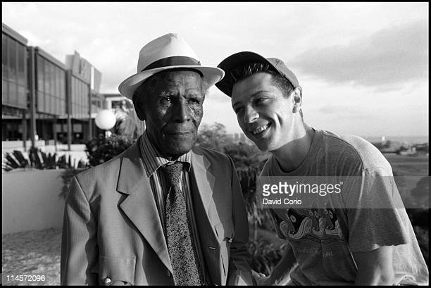 Calypso singer Roaring Lion posed with radio presenter Andy Kershaw outside the Hilton Hotel in Port Of Spain, Trinidad in July 1990.