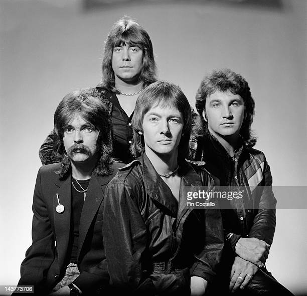 English group Smokie posed in London in July 1980 Left to right drummer Pete Spencer lead guitarist Alan Silson vocalist and guitarist Chris Norman...