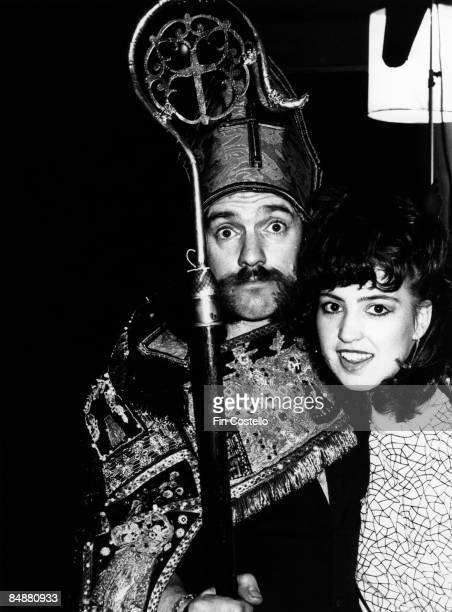 Photo of LEMMY and MOTORHEAD; Lemmy posed dressed as a bishop with an unidentified girl in London in July 1984.