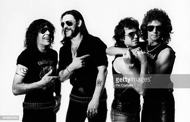 Photo of LEMMY and MOTORHEAD posed in London in July 1984 Left to Right Mick Wurzel Burston Lemmy Kilmister Phil Campbell Pete Gill