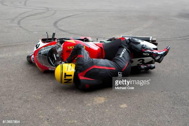 Rider falls off motorcycle whilst exiting the Assembly Area at Goodwood on 1st July 2017 in Chichester England