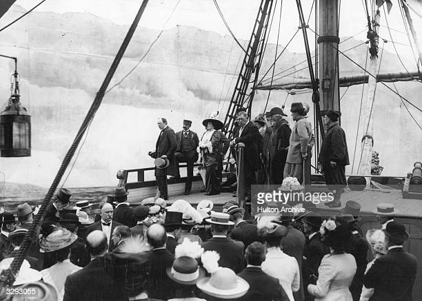 Winston Churchill addresses a crowd from the poopdeck of a replica of Sir Francis Drake's 'Golden Hind' on Armada Day at Earls Court Behind him is...