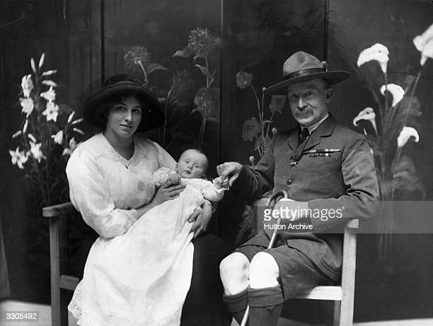 The English soldier Robert Stephenson Smyth 1st Baron BadenPowell who founded the Boy Scouts in 1908 On the left is his wife Lady BadenPowell holding...