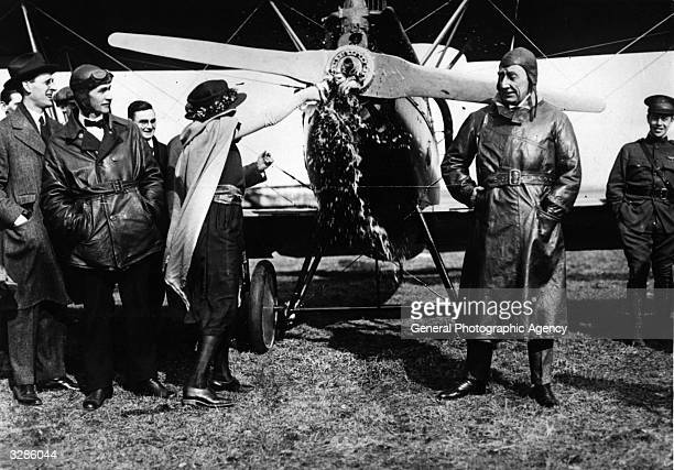 Polar explorer Captain Roald Amundsen and pilot Oskar Omdal with the Curtiss Oriole 'Kristine' which they will use on polar expeditions With them is...