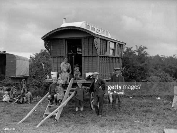 A gypsy family with their caravan parked on Epsom Downs for Derby day