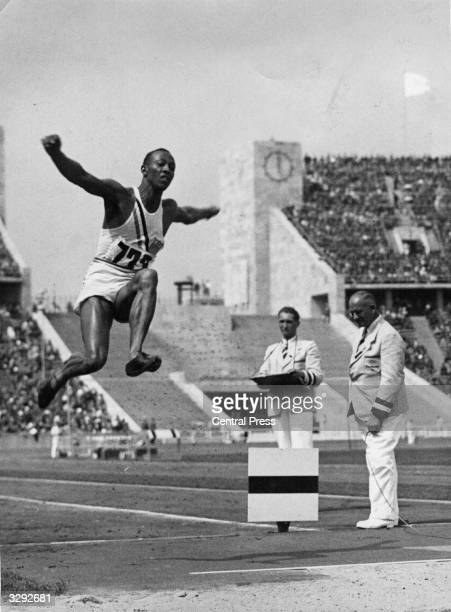 Athlete Jesse Owens flies through the air during the long jump event at the Olympic Games in Berlin He won 4 gold medals and Hitler left the stadium...