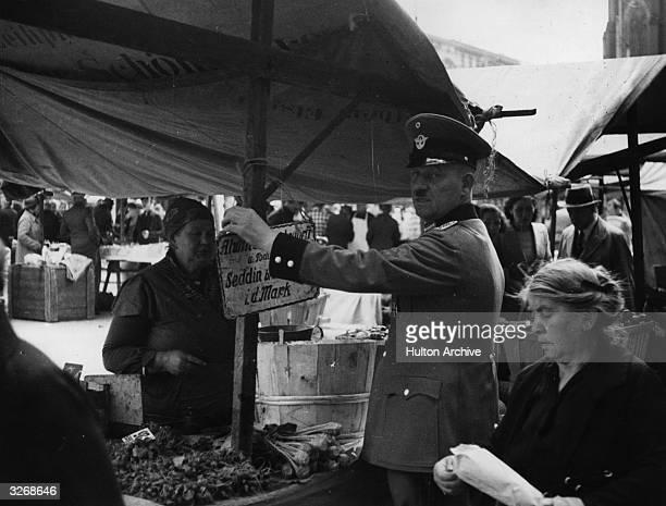 A officer in a street market in Berlin 1939