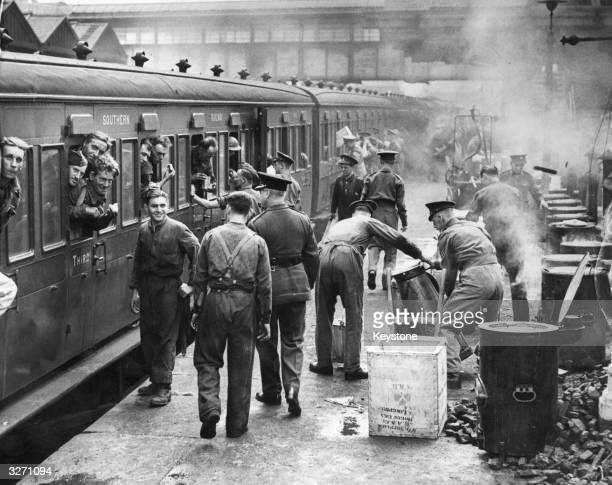 A cook house set up on a London station platform England serving hot food to servicemen arriving from northern France following the evacuation of...