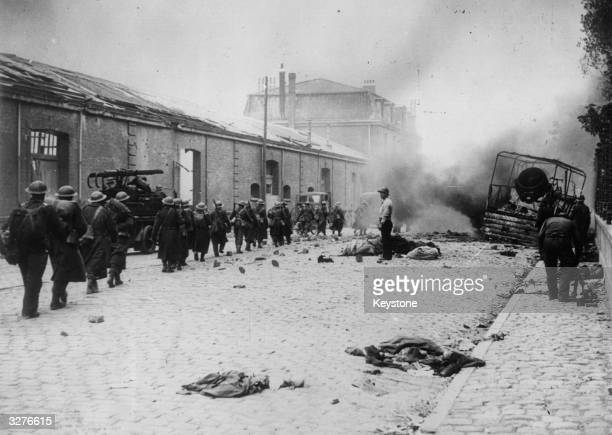 A street in Dunkirk under heavy bombardment during the German attempt to take the town before the evacuation of the allied armies A column of British...